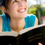 Teen girl holding Bible