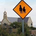 Children crossing sign with church in the background