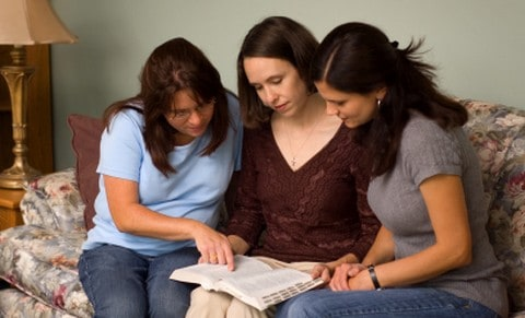 Christian women having a devotion together.
