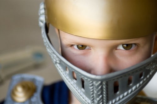 Boy wearing helmet armor of God