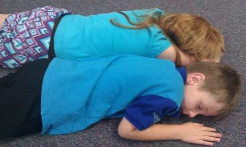 Children sleeping on the floor.
