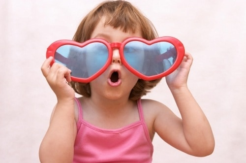 Little girl with love glasses